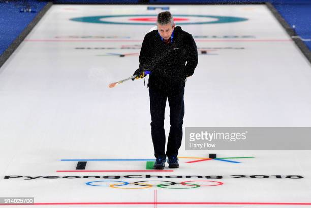 Mark Callan sprays water as he prepares the ice at the Gangneung Curling Centre ahead of the PyeongChang 2018 Winter Olympics on February 4 2018 in...