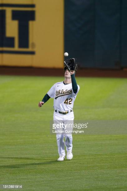 Mark Canha of the Oakland Athletics catches a fly ball hit by Willi Castro of the Detroit Tigers in the top of the seventh inning at RingCentral...
