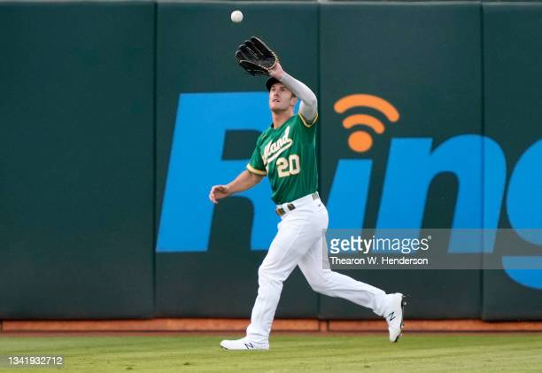 Mark Canha of the Oakland Athletics catches a fly ball off the bat of J.P. Crawford of the Seattle Mariners in the top of the first inning at...