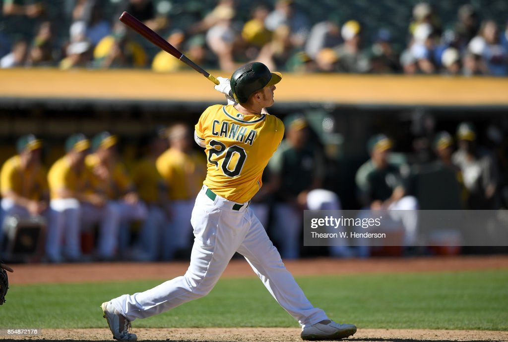 Mark Canha #20 of the Oakland Athletics hits a walk-off solo home run to defeat the Seattle Mariners 6-5 at Oakland Alameda Coliseum on September 27, 2017 in Oakland, California.