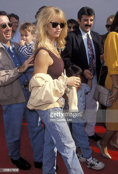 Mark Canton Goldie Hawn and son during 'Aladdin' Benefit Premiere at El Captian Theater in Hollywood California United States