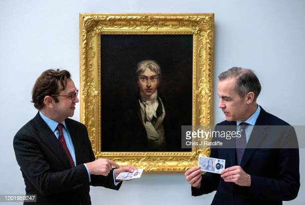 Mark Carney, Governor of the Bank of England, and Alex Farquharson, Director of Tate Britain, pose for photographs with the new twenty pound note in...