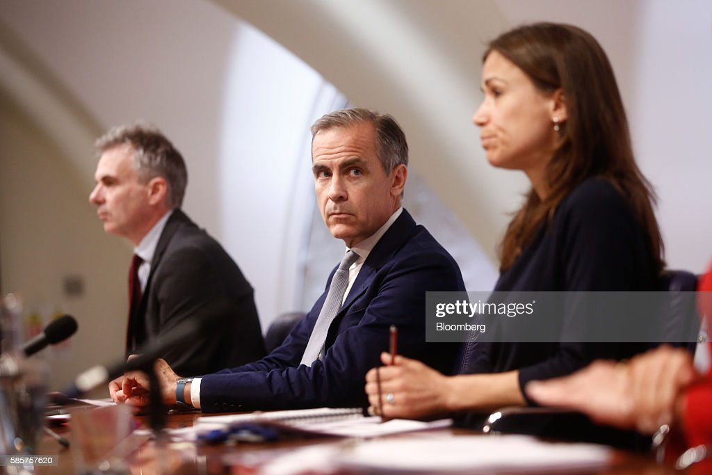 Mark Carney, governor of the Bank of England (BOE), center, pauses as Ben Broadbent, deputy governor for monetary policy at the Bank of England (BOE), left, and Jenny Scott, executive director of communications at the Bank of England (BOE), look on during the bank's quarterly inflation report news conference in the City of London, U.K., on Thursday, Aug. 4, 2016. The pound fell for a second day after the Bank of England cut interest rates for the first time since March 2009, part of a suite of stimulus measures to help boost the economy after the U.K.s vote to leave the European Union in June. Photographer: Simon Dawson/Bloomberg via Getty Images Photographer: Simon Dawson/Bloomberg via Getty Images