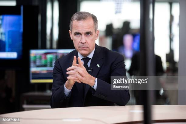 Mark Carney governor of the Bank of England gestures during a Bloomberg Television interview at the One Planet Summit in Paris France on Tuesday Dec...