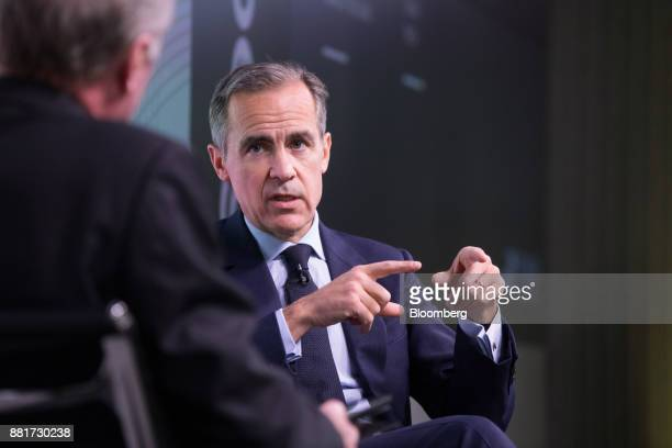 Mark Carney governor of the Bank of England gestures while answering a question after delivering a speech a FICC Markets Standards Board event in...