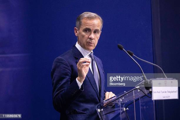 Mark Carney governor of the Bank of England gestures while delivering a speech during the 75th anniversary of the Bretton Woods system of monetary...