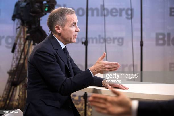 Mark Carney governor of the Bank of England gestures while speaking during a Bloomberg Television interview at the One Planet Summit in Paris France...