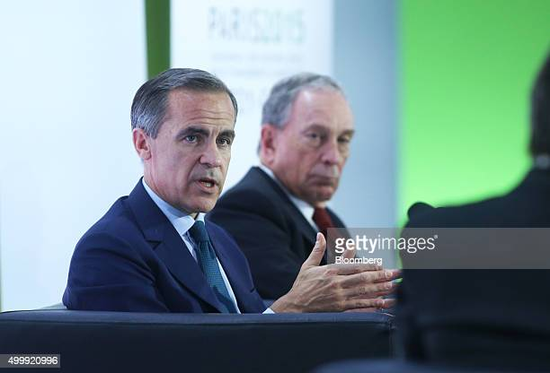 Mark Carney governor of the Bank of England left speaks during a news conference as Michael Bloomberg United Nations special envoy for cities and...
