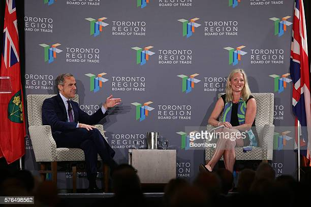 Mark Carney governor of the Bank of England left speaks with Catherine McKenna minister of environment and climate change for Canada during a Toronto...