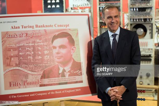 Mark Carney governor of the Bank of England poses for a photograph beside the concept design for the new Bank of England fifty pound banknote...