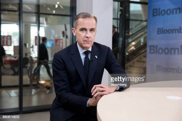 Mark Carney governor of the Bank of England poses for a photograph ahead of a Bloomberg Television interview at the One Planet Summit in Paris France...