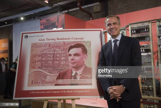 Mark Carney governor of the Bank of England poses for photographs as he presents a concept design following a news conference to announce the...