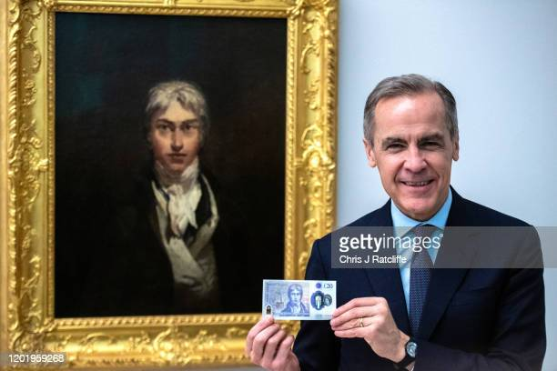Mark Carney, Governor of the Bank of England, poses for photographs with the new twenty pound note in front of J.M.W. Turner's self-portrait from...