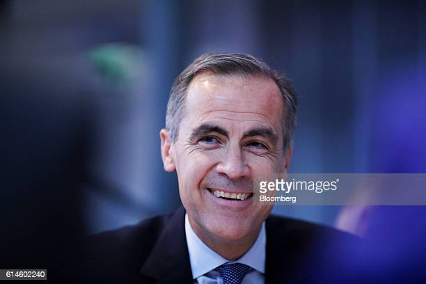 Mark Carney governor of the Bank of England reacts as he meets with attendees during a round table discussion at the Future Forum event in Birmingham...
