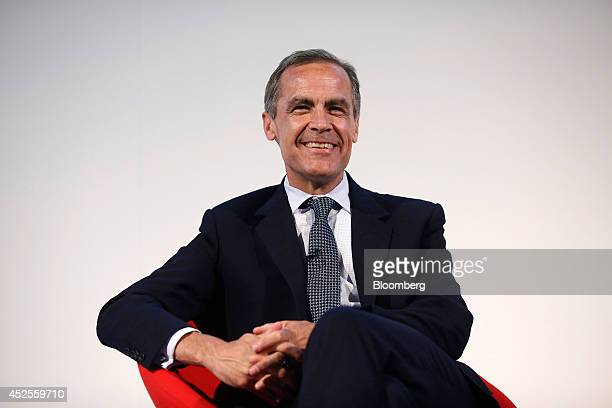 Mark Carney governor of the Bank of England reacts as he sits and listens to speeches during the Commonwealth Games Business Conference in Glasgow UK...