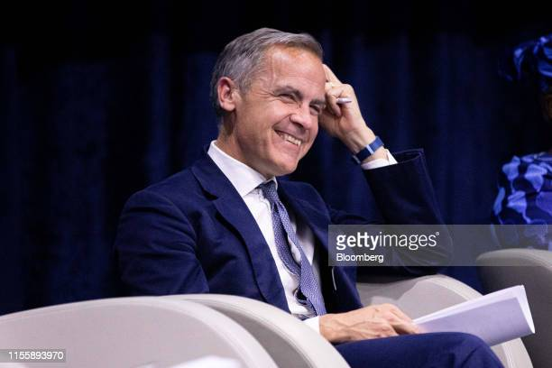 Mark Carney governor of the Bank of England reacts during a panel discussion during the 75th anniversary of the Bretton Woods system of monetary...