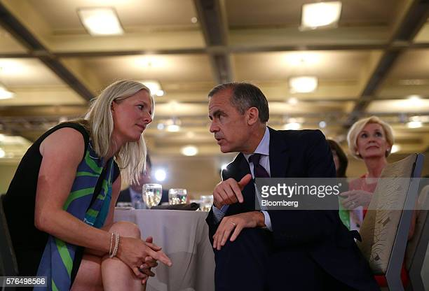 Mark Carney governor of the Bank of England right speaks with Catherine McKenna minister of environment and climate change for Canada before going on...