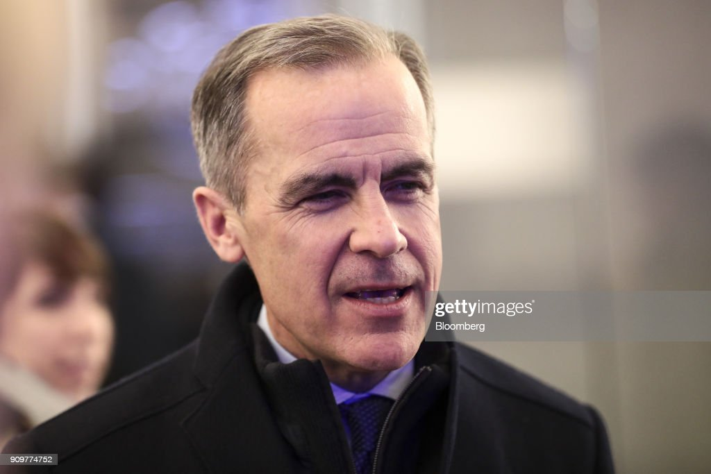 Mark Carney, governor of the Bank of England, speaks to an attendee between sessions on day two of the World Economic Forum (WEF) in Davos, Switzerland, on Wednesday, Jan. 24, 2018. World leaders, influential executives, bankers and policy makers attend the 48th annual meeting of the World Economic Forum in Davos from Jan. 23 - 26. Photographer: Simon Dawson/Bloomberg via Getty Images