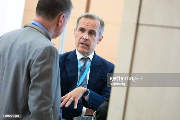 Mark Carney governor of the Bank of England speaks with an attendee during the 75th anniversary of the Bretton Woods system of monetary management in...