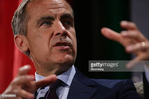 Mark Carney governor of the Bank of England speaks with Catherine McKenna minister of environment and climate change for Canada not pictured during a...