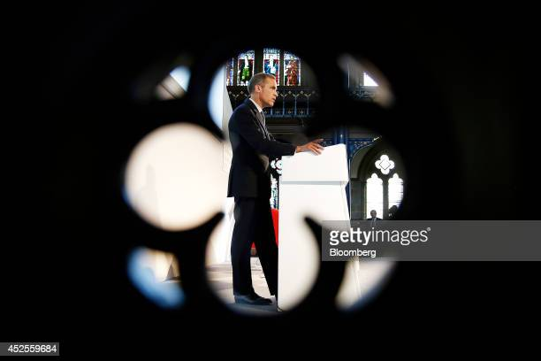 Mark Carney governor of the Bank of England stands at the podium as he speaks during the Commonwealth Games Business Conference in Glasgow UK on...