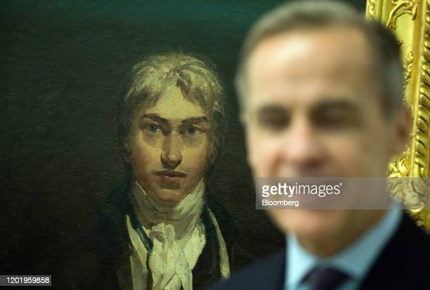 Mark Carney governor of the Bank of England stands in front of JMW Turner's self portrait during an event to mark the circulation of the new 20pound...