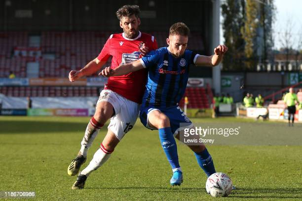 Mark Carrington of Wrexham battles for possession with Rhys NorringtonDavies of Rochdale during the FA Cup First Round match between Wrexham and...