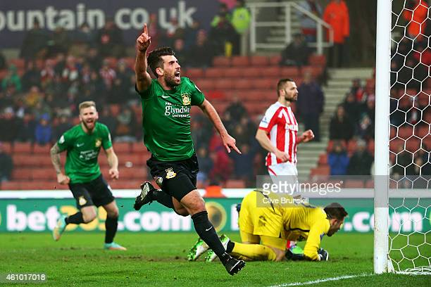Mark Carrington of Wrexham celebrates after scoring the opening goal during the FA Cup Third Round match between Stoke City and Wrexham at Britannia...