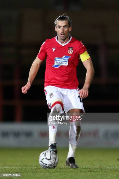 Mark Carrington of Wrexham in possession during the Vanarama National League match between between Wrexham and Woking at Racecourse Ground on...