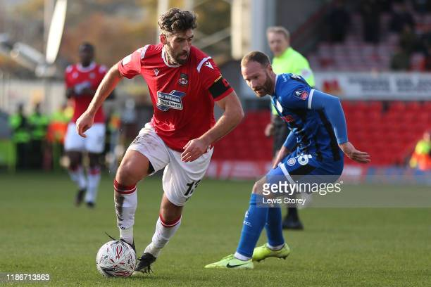 Mark Carrington of Wrexham turns away during the FA Cup First Round match between Wrexham and Rochdale at Racecourse Ground on November 10 2019 in...