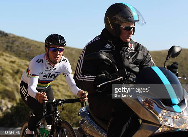 Mark Cavendish is motorpaced by Race Coach Rod Ellingworth during a pre-season Team SKY training camp in Puerto Alcudia on January 23, 2012 in...
