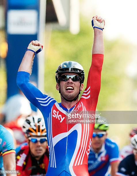 Mark Cavendish of Britain crosses the finish line to win the Men Elite Road Race competition on September 25 2011 in Copenhagen The UCI Cycling Road...