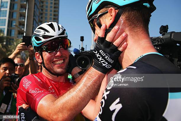 Mark Cavendish of Great Britain and Etixx QuickStep celebrates with team mate Tony Martin of Germany after winning the Dubai Tour and also stage four...