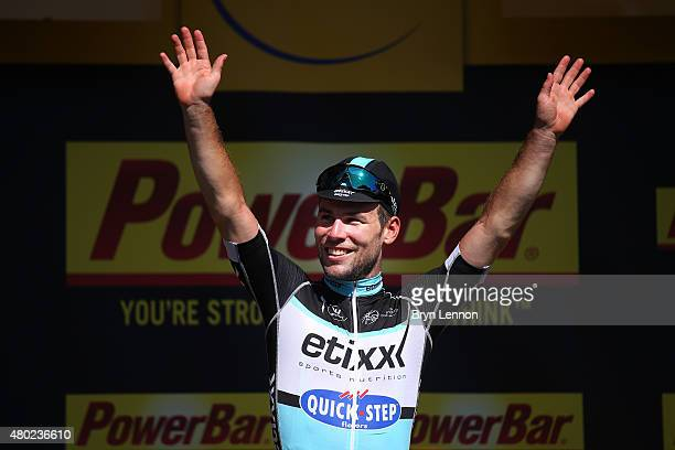 Mark Cavendish of Great Britain and Etixx-Quick Step celebrates his stage victory on the podium following stage seven of the 2015 Tour de France, a...