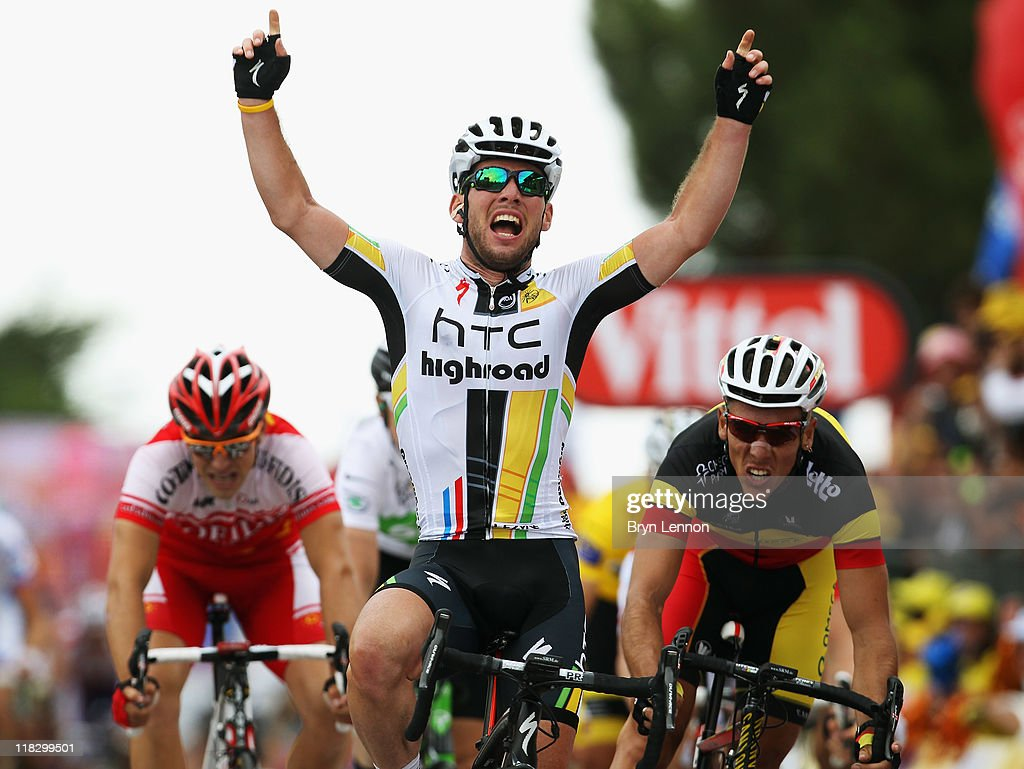 Mark Cavendish of Great Britain and HTC Highroad crosses the finishline and celebrates winning stage five of the 2011 Tour de France from Carhaix to Cap Frehel on July 6, 2011 in Cap Frehel, France.