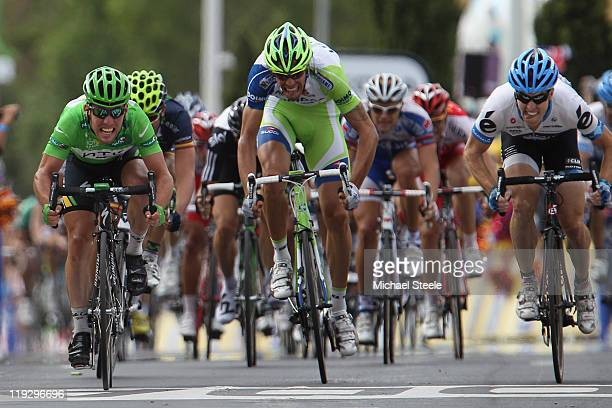 Mark Cavendish of Great Britain and HTC Highroad team claims his nineteenth stage victory from Tyler Farrar of USA and team Garmin Cervelo and...