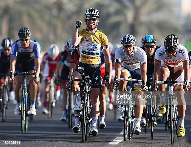 Mark Cavendish of Great Britain and Omega Pharma - Quick Step celebrates as he crosses the line to win stage six, and the overall classification, of...