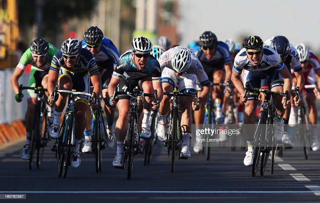 Mark Cavendish of Great Britain and Omega Pharma - Quick Step sprints for the finishline on his way to winning stage three of the Tour of Qatar from Al Wakra to Mesaieed on February 5, 2013 in Doha, Qatar.