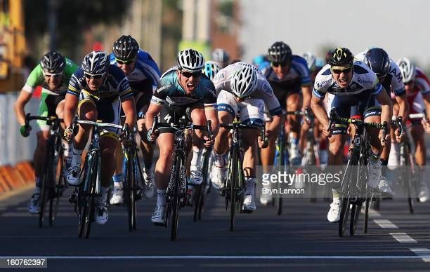 Mark Cavendish of Great Britain and Omega Pharma Quick Step sprints for the finishline on his way to winning stage three of the Tour of Qatar from Al...