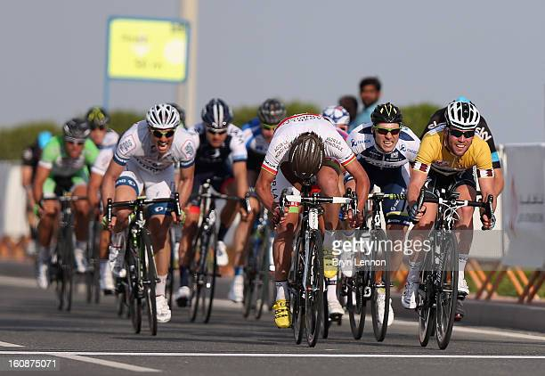 Mark Cavendish of Great Britain and Omega Pharma - Quick Step sprints to victory on stage five of the 2013 Tour of Qatar from Al Zubara Fort to...