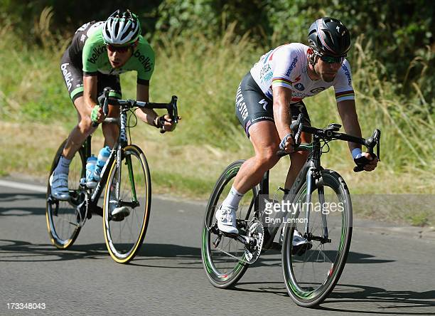 Mark Cavendish of Great Britain and Omega Pharma-Quickstep and Laurens Ten Dam of the Netherlands and Belkin in action during stage thirteen of the...