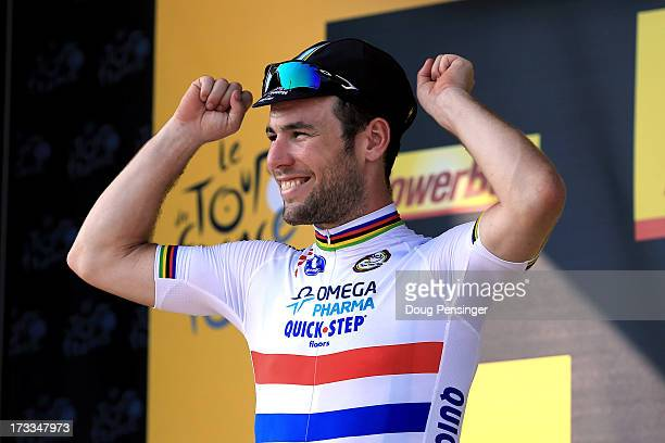 Mark Cavendish of Great Britain and Omega Pharma-Quickstep celebrates on the podium after winning stage thirteen of the 2013 Tour de France, a 173KM...