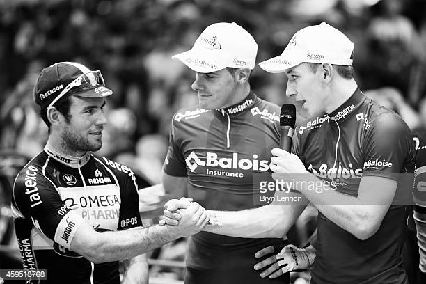 Mark Cavendish of Great Britain and Omega PharmaQuickStep shakes hands with Kenny De Ketele of Belgium and Team Baloise after finishing second in the...
