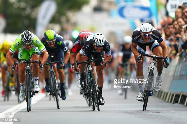 Mark Cavendish of Great Britain and Omega PharmaQuickStep sprints against Marcel Kittel of Germany and the GiantShimano Team during stage 8b of the...