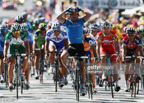 Mark Cavendish of Great Britain and Team Colombia celebrates as he crosses the line to win stage five of the 2008 Tour de France from Cholet to...