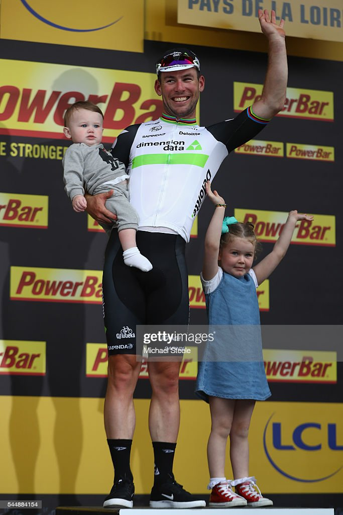 Mark Cavendish of Great Britain and Team Dimension Data acknowledges the crowds applause alongside his daughters Frei (L) and Delilah Grace (R) on the podium after stage three of Le Tour de France from Granville to Angers on July 4, 2016 in Angers, France.
