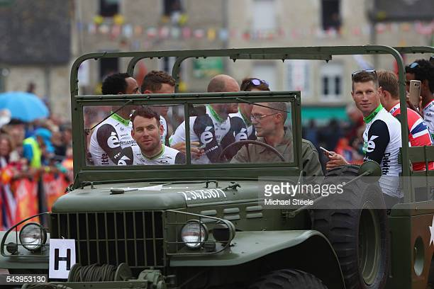 Mark Cavendish of Great Britain and Team Dimension Data arrives in a first world war military vehicle during the team presentations on June 30 2016...
