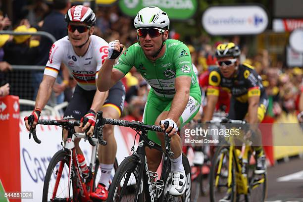 Mark Cavendish of Great Britain and Team Dimension Data celebrates the stage win from Andre Greipel of Germany and Lotto Soudal during stage three of...