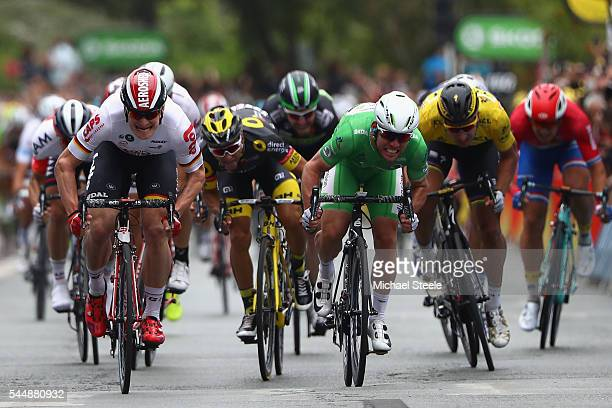 Mark Cavendish of Great Britain and Team Dimension Data sprints for the finishing line to claim the stage win from Andre Greipel of Germany and Lotto...