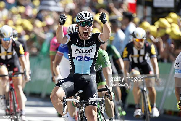 Mark Cavendish of Great Britain and Team Etixx-Quick Step celebrates winning the sprint finish during stage seven of the 2015 Tour de France, a 190.5...